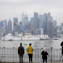Onlookers Witness Arrival of Navy Hospital Ship in NYC, Ignore Social Distancing Orders